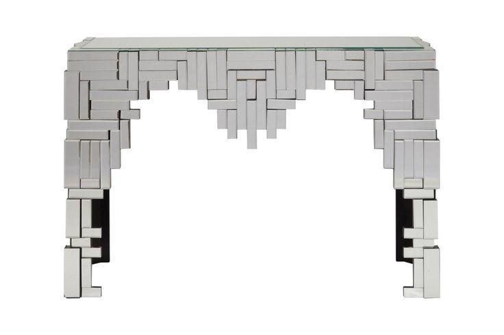 Зеркальная консоль Maestro — это роскошный предмет мебели, который придется по вкусу ценителям изысканных и дорогих вещей. Основание аксессуара изготовлено из МДФ, а по всей его поверхности расположены зеркала, отражающие блики света и визуально увеличивающие пространство, за счет этого консоль идеально впишется в любую комнату вашего дома. Украсьте ваш интерьер!             Материал: МДФ, Зеркальное стекло.              Бренд: DG Home.              Стили: Арт-деко.              Цвета…