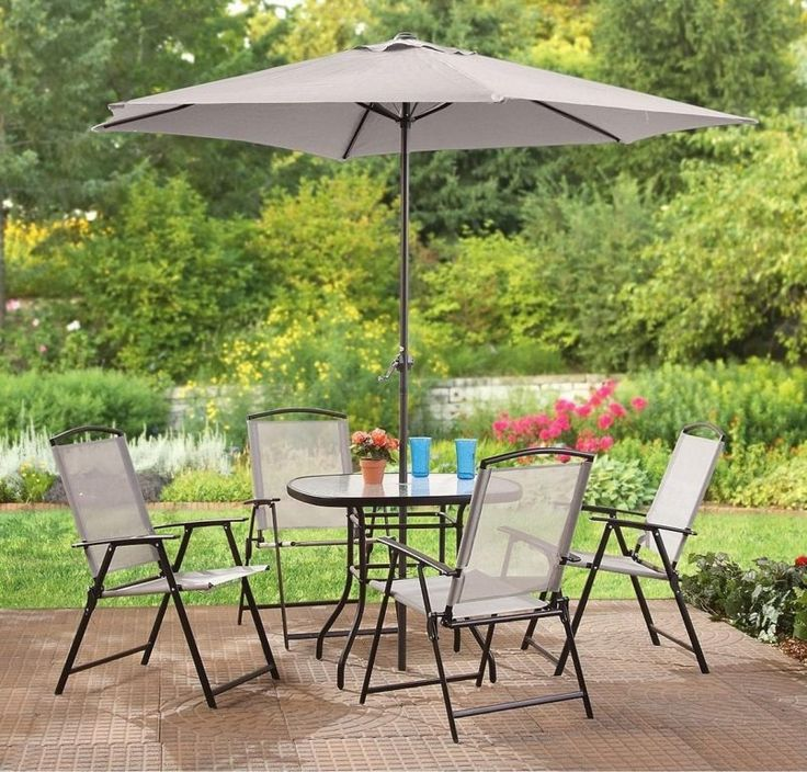 Outdoor Black Classic Stained Steel Dining Set With Pink Flower Also Brown  Pot And Patio Umbrella