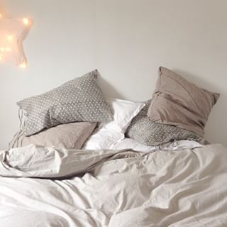 Or recline in this greige bedding. | 19 Deliciously Messy Beds You'll Want To Crawl Into Right Now
