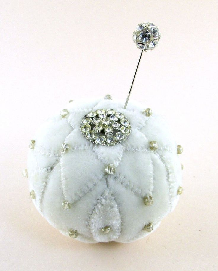 """2013 OOAK Janie Comito ~ Winter Velvet Pin Cushion with Rhinestone Button & Pin~ It snowed last night in Seattle, just enough to leave a sparkly sheen on everything this morning.  In celebration of snow time, Janie has created a winter pin cushion of white velvet.  It is handsewn with petal appliques decorated with pearl sheen glass beads, & a beautiful sparkly vintage rhinestone button perfectly matched by a stick pin with a sparkling rhinestone studded head created by Janie. 3"""" W by 2 1/2""""…"""