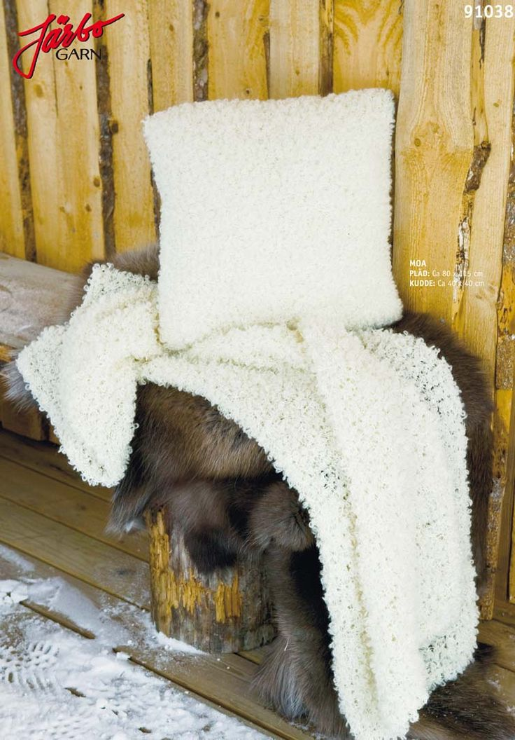 Knitted fur pillow with matching blanket.