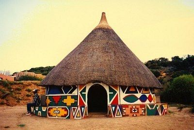 Learning about other cultures and places- A beautiful and colorful African round Ndebele hut in South Africa. An example for decorating for a celebration.