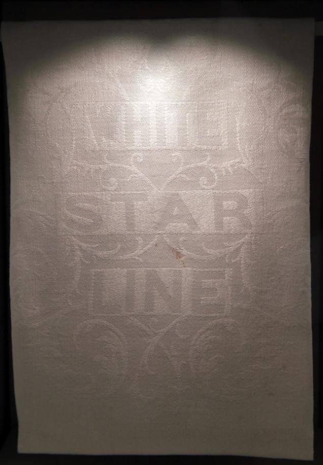 A White Star Line napkin is exhibited at the SeaCity Museum's Titanic exhibition in Southampton, England, where the ship initially set sail. The new SeaCity Museum opened up to the public exactly 100 years, down to the time, when the Titanic set sail. The museum cost a staggering 16 million and promises to tell the story of the doomed crew and passengers.
