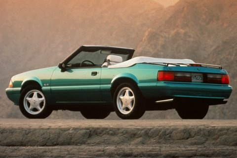 1993 Ford Mustang LX 5.0 convertible. In my senior year of high school, I had this car tacked to the wall of my bedroom. I couldn't afford it then, but I'd love to buy one now...in Calypso Green, just like this one.
