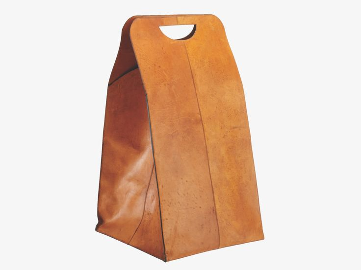 Foldable, hand finished leather laundry bag with clasp and magnetic closure.