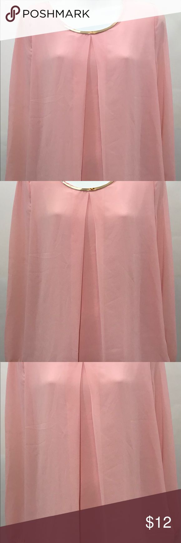 """Ladies Blouse Pink Sheer This is a Ladies Blouse. It says XXL on Tag but fits smaller. Please check measurements before purchasing. The material tag is not on top but It is a sheer material with an inside lining. The sleeves are sheer with no lining.  There is an attached metal front piece at top of Blouse to look like a necklace. Very beautiful Blouse.  Approx. Measurements are laying flat (not doubled) Armpit to Armpit 20"""" Length from back top to bottom 27"""" Sleeves 24"""" Thank You for…"""