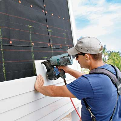 Considering re-siding your house? Here's everything you need to know about buying and installing fiber-cement siding. | Photo: Courtesy Matt Thompson/Thompson Construction | thisoldhouse.com
