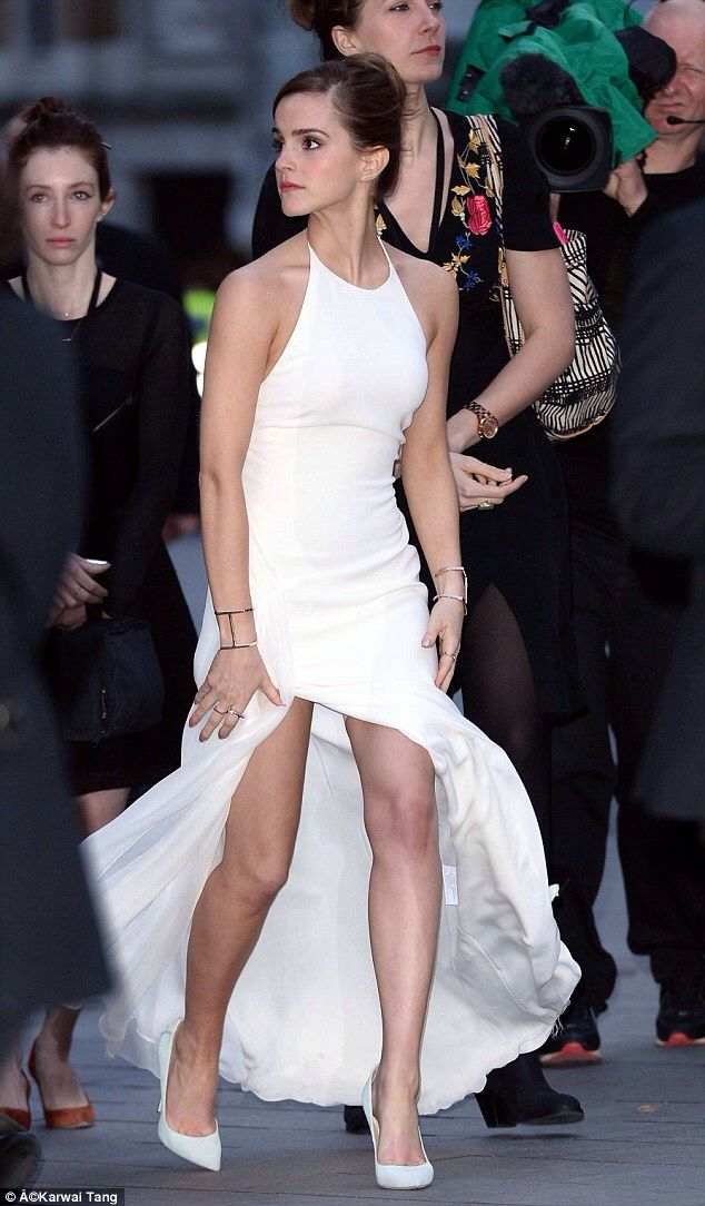 Emma Watson shows off stunning figure in daring thigh-split gown as she attends UK premiere of Noah