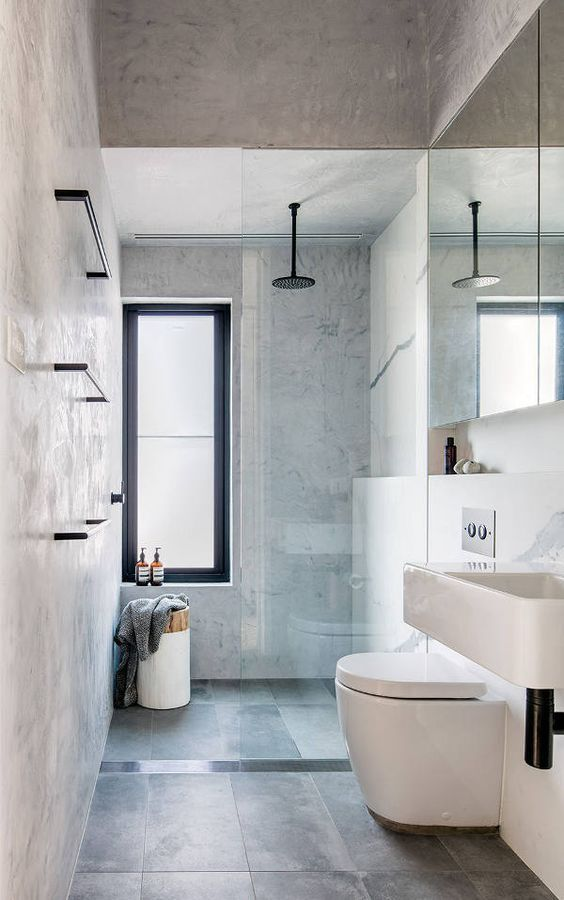 Another shelf design acting as a shower alcove. While the shelf continues into the vanity space, the line is broken by a straight, vertical wall for the…
