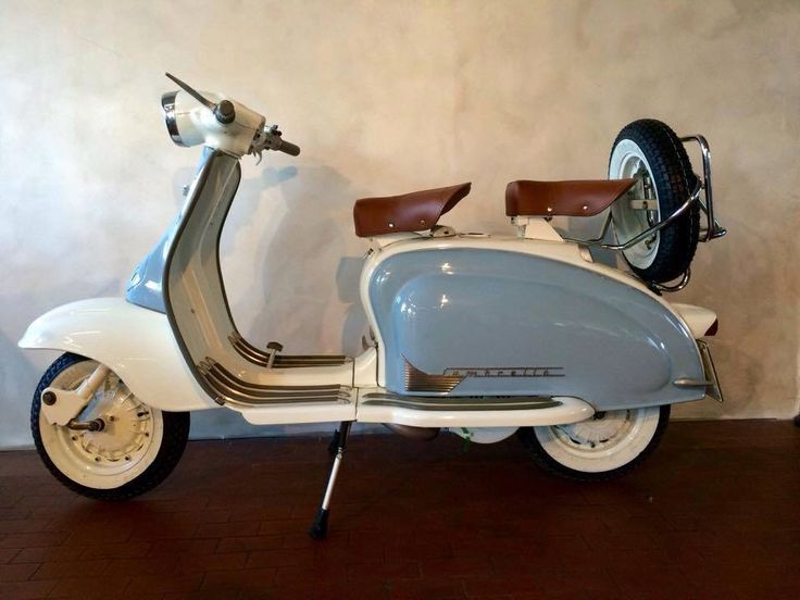 Lambretta. It isn't only incredibly stylish but it provides a moment so romantic, by bringing together two people in an imbrace of unity, trust and commonality.