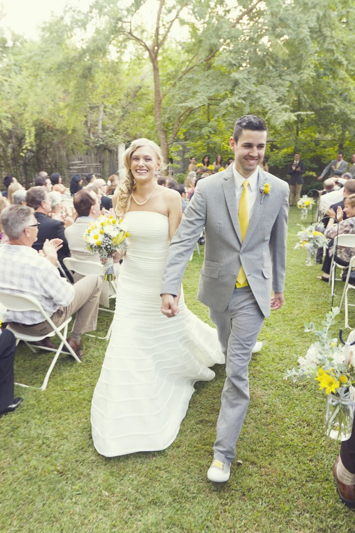 love everything about this...ceremony outdoors, groom in a NON-white tux, simple but gorgeous dress, and of course all the YELLOW :)))
