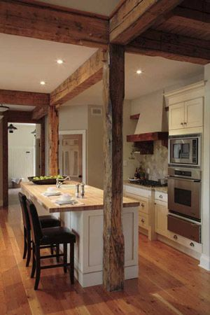 French Timber Frame Kitchen, oven and beam, butcher block top, white cabinets, pulls and beams