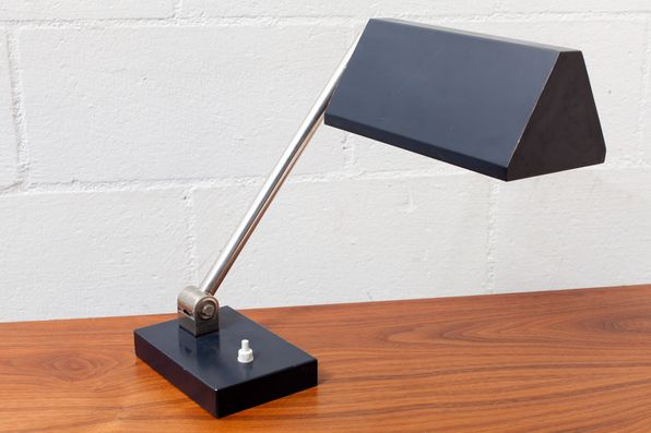Hala Zeist Geometric Industrial Desk Lamp Hala Zeist / Netherlands Great Blue Enameled Metal Triangular Shade with Articulating Arm. Item: 	L465 B Price: 	$295.00 Size: 	4.75 x 11 x 14.25