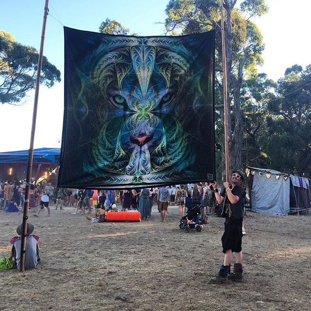 One of my huge artwork on tapestry at the Sunset stage  @rainbowserpentfestival 2017 Australia  Festival decoration. http://www.pumayana.com
