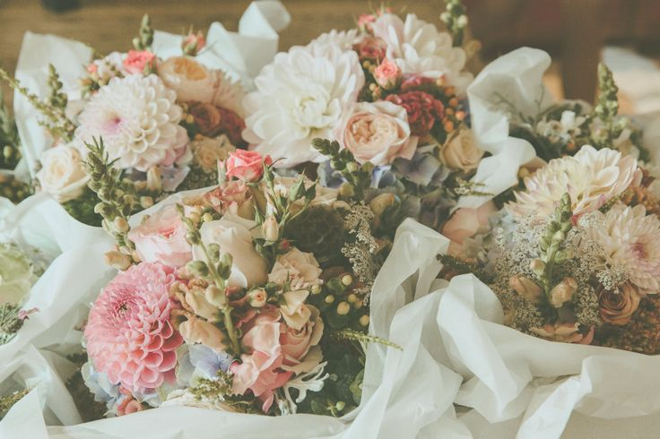 bouquets in their delivery box - love the vintage mix