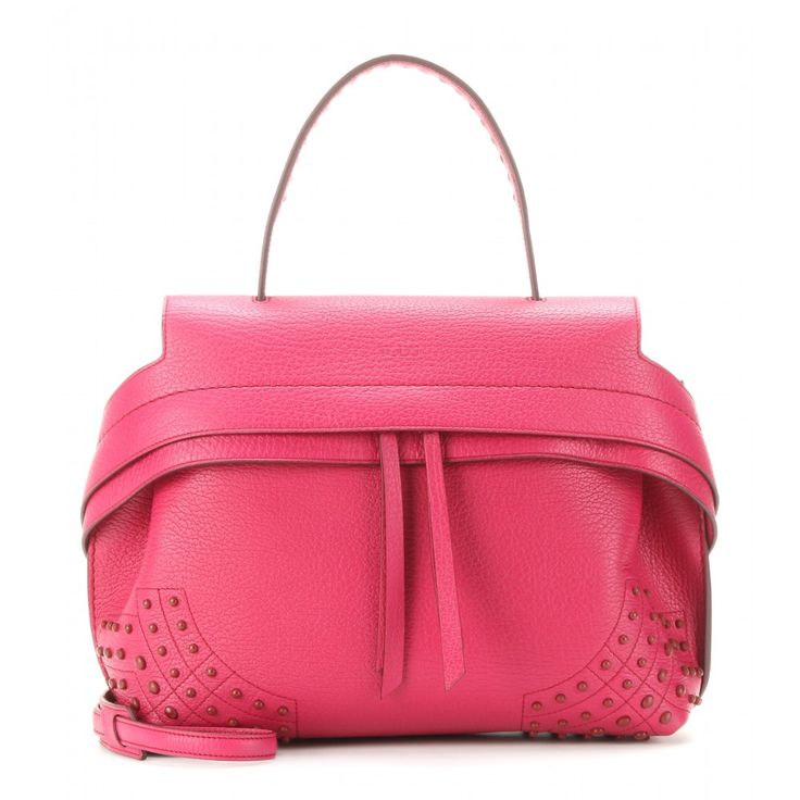 Tod's - Wave Small leather tote - Breathe new life into your wardrobe with the 'Wave' bag from Tod's in this bright fuchsia shade. The grainy leather design features a concealed two-way zipped top and tonal studs for a textured yet clean silhouette. Carry yours in the day with denim or to a dinner date next to an LBD. seen @ www.mytheresa.com