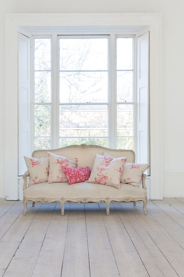 @ Cabbages and Roses ~ I love this sofa filled with floral pillows!