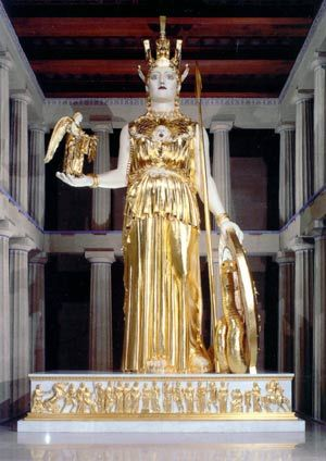 Athena Parthenos is 41 feet, 10 inches tall. There are about 12 inches between the top of her helmet and the ceiling beams. Her weight is estimated at 12 tons. The statue of Nike, the goddess of victory, in Athena's right hand is 6 feet 4 inches tall. Nike holds a wreath of victory preparing to crown Athena.
