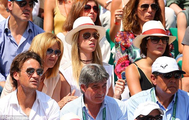 Watching on: Nadal's mother Ana Maria (left), sister Maria (centre) and girlfriend Xisco Perello (right) in attendance