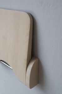 Uppfälld väggpall av björk.    Folded wall stool of birch.