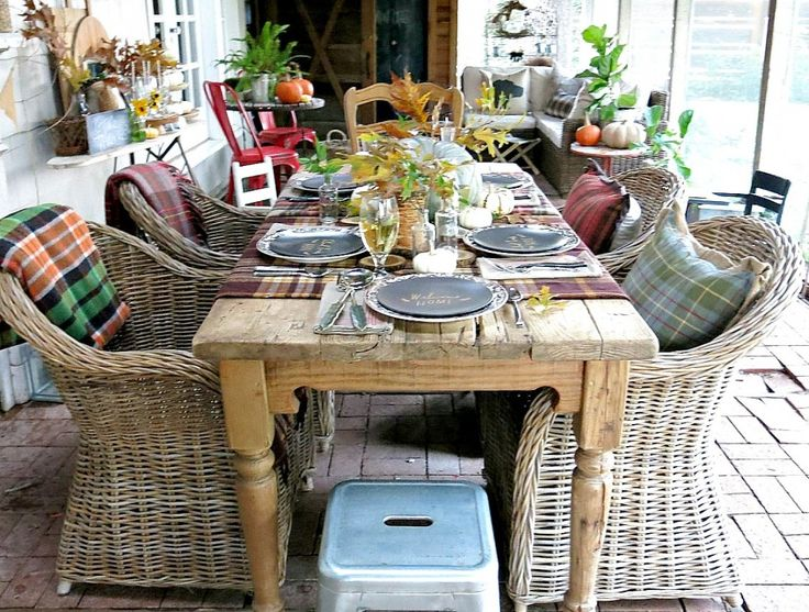 you could recreate this with the 20 dollar ikea wicker chair and a garage sale table!
