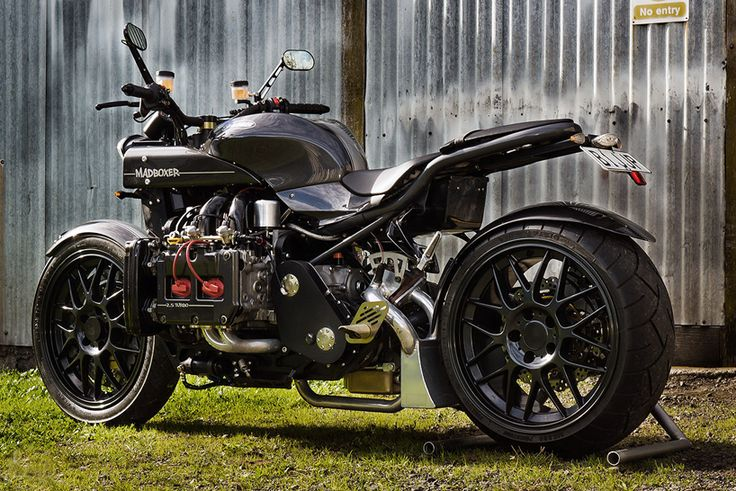 the mad boxer takes a subaru WRX engine and pairs it with a kawasaki fuel tank, packing its ferocity in a bespoke shell.