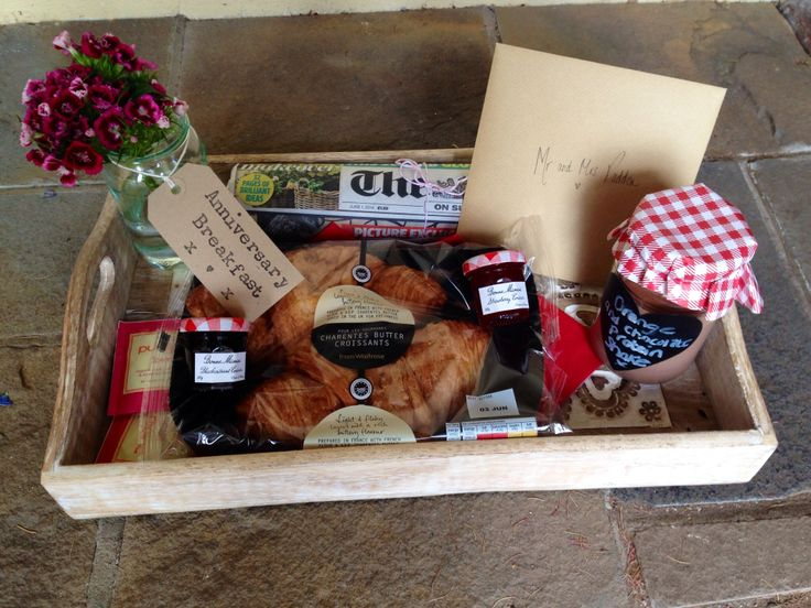 First anniversary breakfast for a friend. Croissants, protein shake, mini jams, pukka love tea and flowers on a tray and left on the doorstep