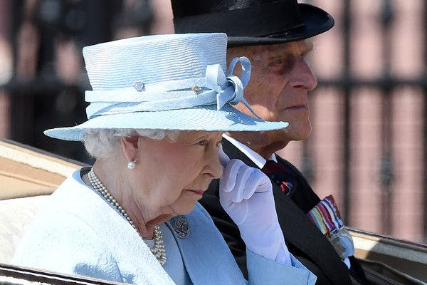 Britain's Queen Elizabeth II and Britain's Prince Philip, Duke of Edinburgh travel in a horse-drawn carriage past Buckingham Palace on their way to Horse Guards Parade for the Queen's Birthday Parade, 'Trooping the Colour', in London on June 17, 2017....The ceremony of Trooping the Colour is believed to have first been performed during the reign of King Charles II. In 1748, it was decided that the parade would be used to mark the official birthday of the Sovereign. More than 600 guardsmen…