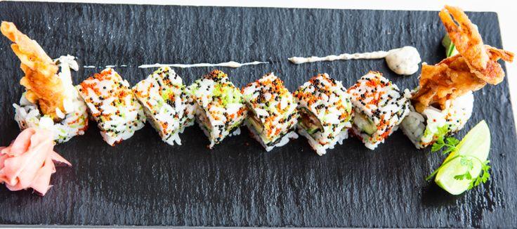 Phuket Shrimp Roll: Panko Shrimp, Mango & Spring Onions, topped with Wakame Salad