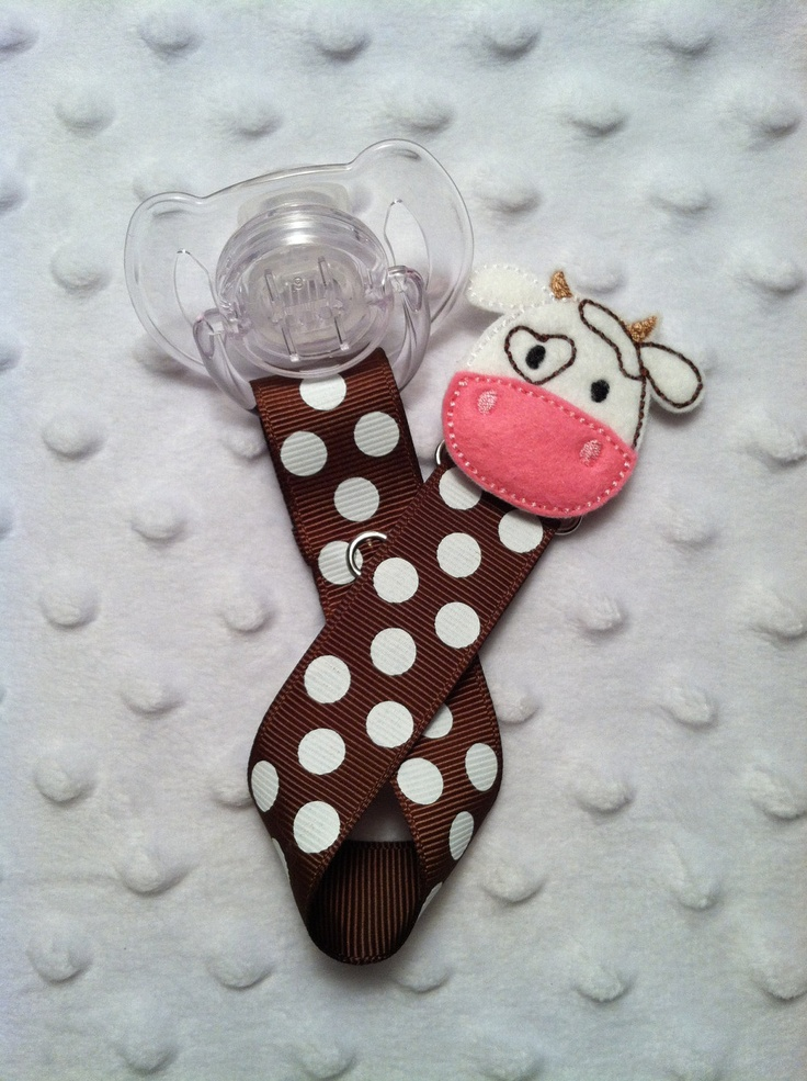 Brown with White Polka Dots and Adorable Cow Face Applique Hiding Clip Pacifier Clip Paci Clip Soothie Binky. $6.50, via Etsy.