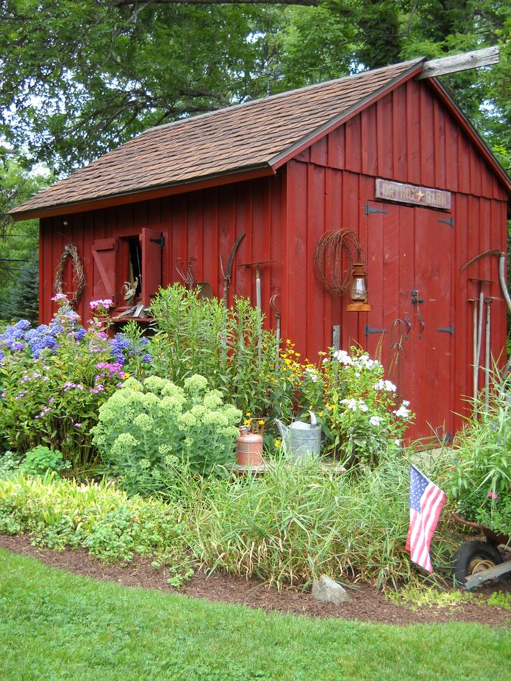 Displaying vintage gardening tools, on or around a shed, helps to connect the outside of a primitive home to the inside ~ this is great but I'd like more windows please!