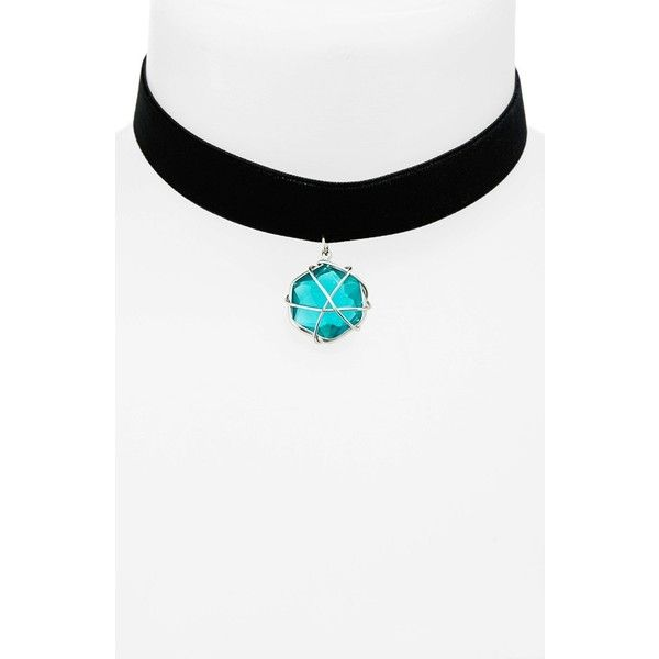 A light-catching emerald crystal secured in a silvertone setting is suspended from a rich, jet black velvet band on this elegant choker. Brand: TOPSHOP. Style …