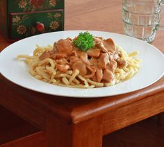 Authentic Geschnetzeltes recipe, a sauce with meat, mushrooms, onions and cream served over spaetzle or egg noodles. Comfort food at its best.