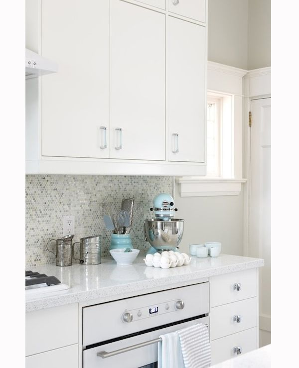 All White Kitchen Features White Ikea Kitchen Cabinets Eco By Cosentino White Diamond Countertops Mosaic Tile Backsplash And Ikea Oven And Turquoise Blue