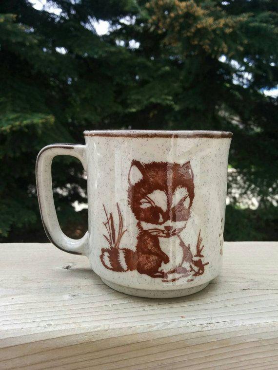 Check out this item in my Etsy shop https://www.etsy.com/listing/281446964/vintage-ceramic-cartoon-raccoon-fish-mug