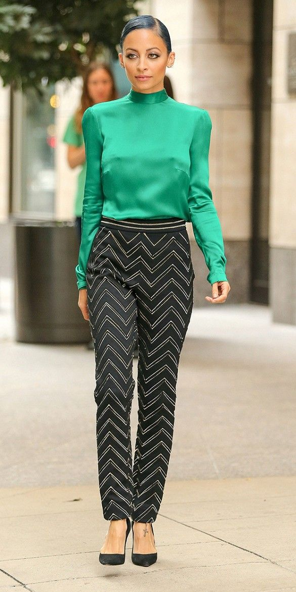 Nicole Richie wears a jewel-tone green silk blouse + chevron printed pants