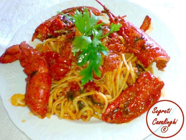 linguine astice,ricetta linguine all'astice,linguine con astice,ricetta passo per passo linguine con astice e salsa,ricetta salsa pomodoro con astice,