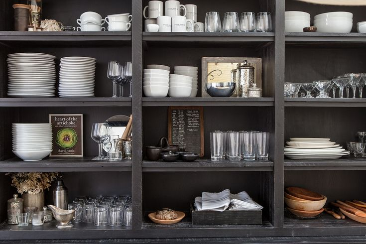 A black hutch (from Restoration Hardware) and open shelving displays dinnerware.