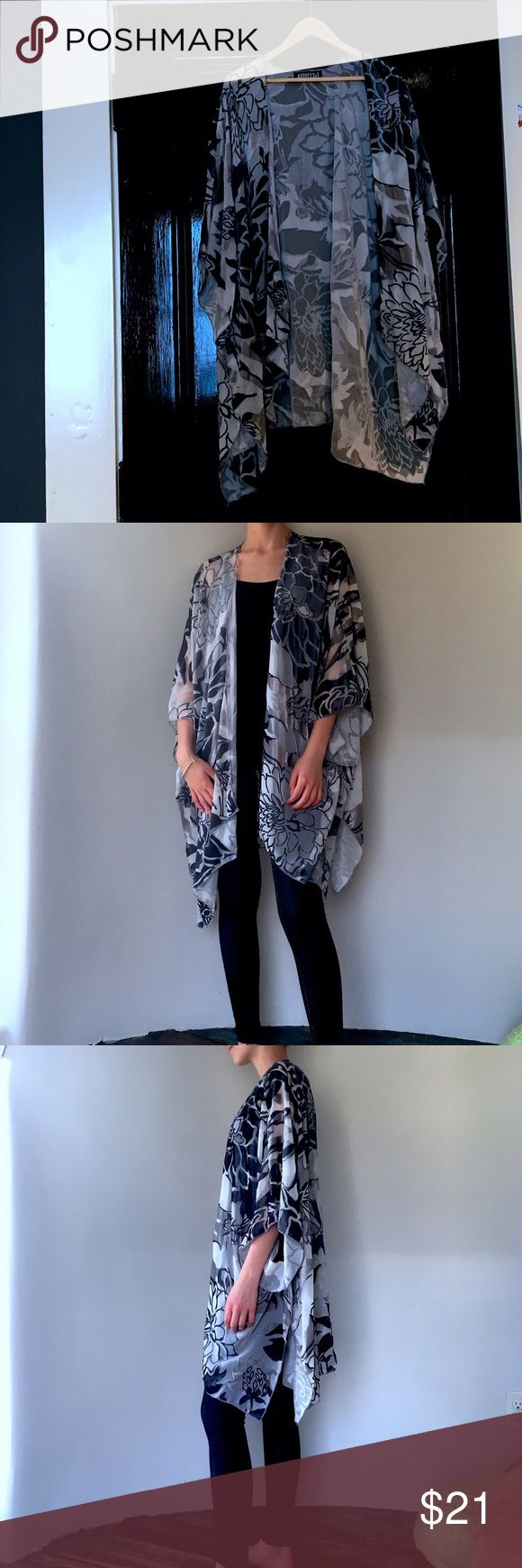 Audrey 3 + 1 floral kimono This is a gorgeous black and grey kimono. It is very soft and it is sheer. It has a very rock n' roll vibe to it! Although it is brand new and has never been worn, it has been hanging in the closet & the plastic straps have put slight stress on the fabric.  Besides that small little flaw...it is gorgeous! audrey 3 + 1 Sweaters Shrugs & Ponchos