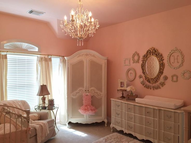 Peachy pink and gold nursery with French provincial dresser & armoire