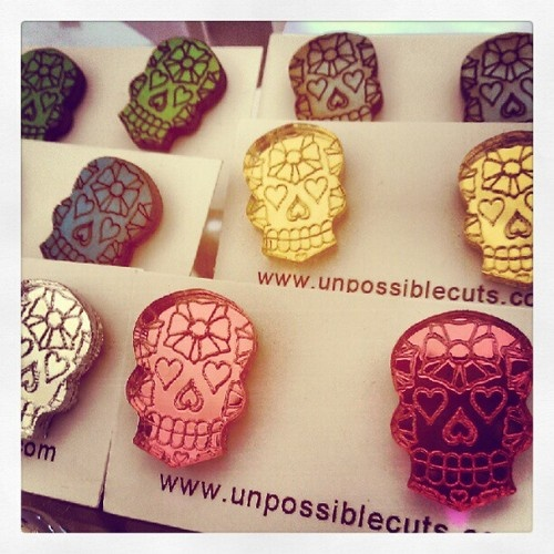 These adorable lasercut 3D calavera earrings by Unpossible Cuts are new in our boutique!