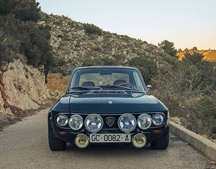This 1971 Lancia Fulvia 1.3S spent most of its life in the Canary Islands prior to recent, fully legal US importation. Said to run and drive very well, the car looks fantastic in Verde Ostende over red with 1.6 HF style flares and enough auxiliary lighting to illuminate a rural runway during a black