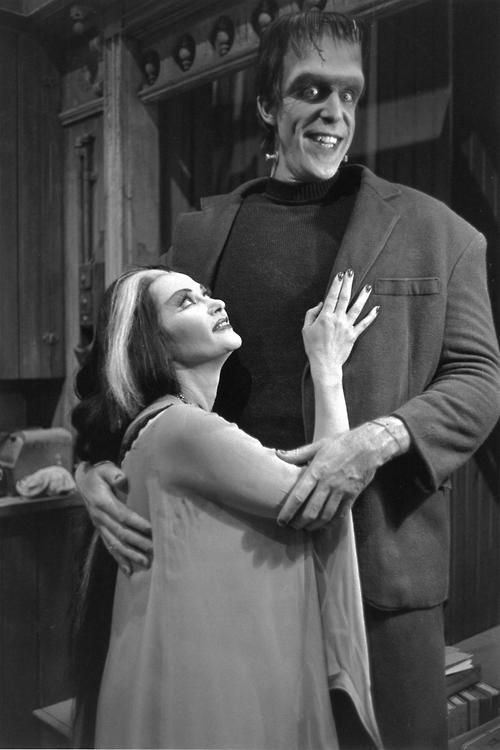 Fred Gwynne as Herman Munster and Yvonne De Carlo as Lily Munster in The Munsters tv show