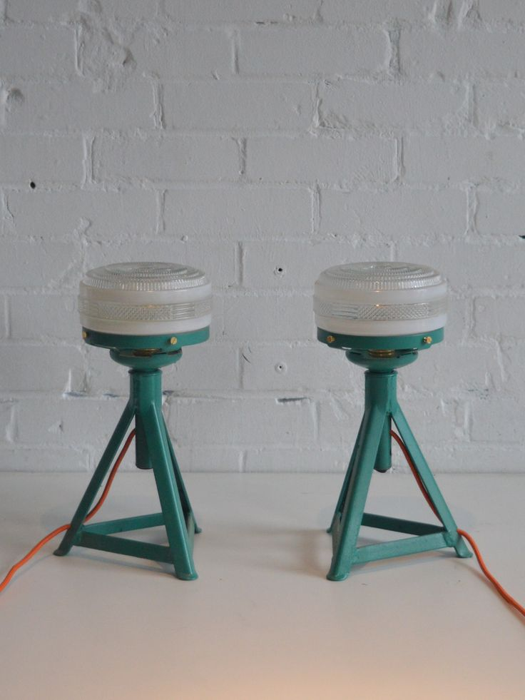 These two lamps are made from car axle stands adapted to fit the two lovely vintage glass shades.