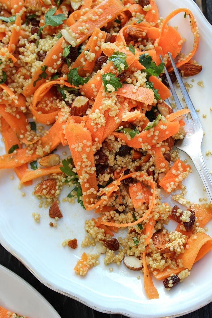 Moroccan carrot salad with spiced quinoa, raisins and almonds. A great salad for summer picnics. Vegan and gluten free. Serves a crowd.