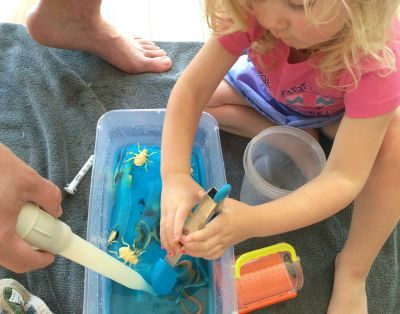 Make a Frozen Bugs sensory bin for your toddler, preschooler, or big kid to explore this summer.