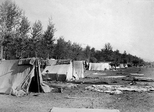 """1886: Chinese camp, Kamloops, British Columbia - In the late 19th century, many Chinese migrant workers came to the """"Golden Mountain"""" (as they called North America) to work on the building of the Canadian Pacific Railway. Wages were low, conditions were harsh, and discrimination was rife - they were hired simply because they were cheap, expendable labour - but for many, even that was wealth compared to what they had back home."""
