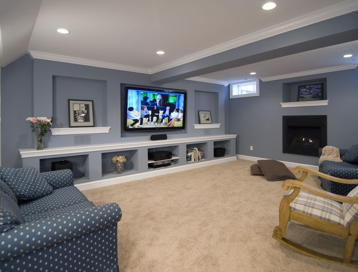 This Remodeled Basement Includes An Entertainment Wall And