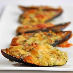 Cheese baked green mussels.Green mussels with Parmesan cheese baked in convention oven.