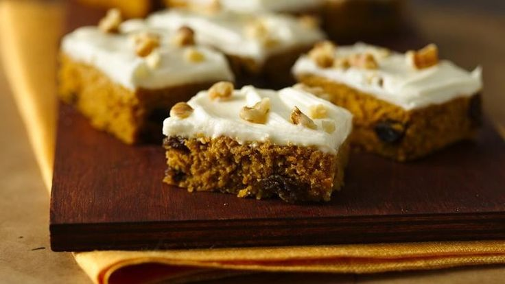 You'll fall in love with these pumpkin bars! They have a light texture, are full of cinnamon, ginger, raisins and nuts, and are topped with cream cheese frosting.